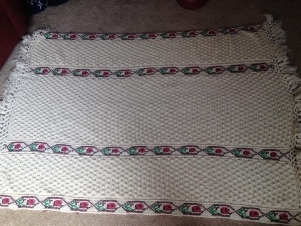 Afghan made of tunisian and popcorn crochet overlaid with top stitching
