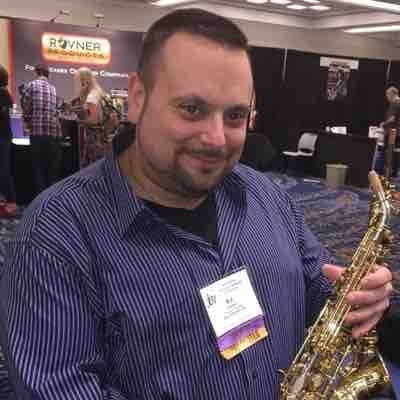 At Jazz Educators Conference holding a Yanagisawa silver sonic soprano.