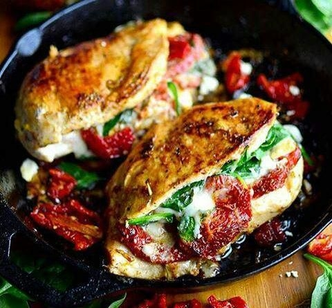 Baked chicken breast stuffed with spinach dried tomatoes over cheese