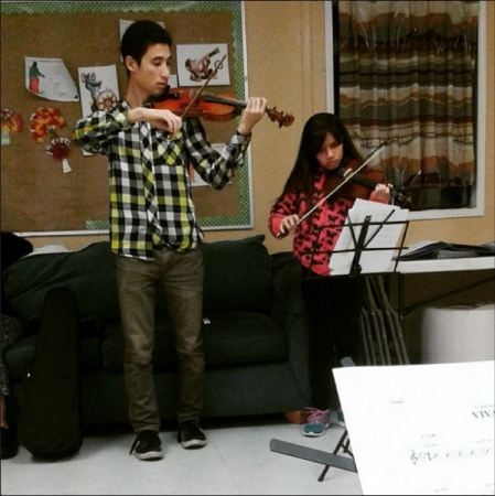 Teaching a student at the CKC-Music community engagement program.