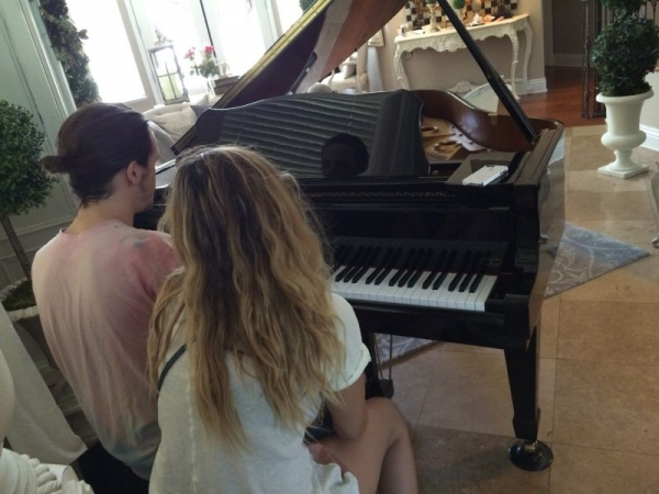 The piano in my home. This is my brother and girlfriend playing. This is one that I would use with students. We also have an upright kawaii.