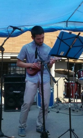 Playing at a local community festival.
