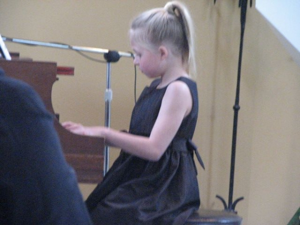 Beautiful performance at a recent student recital. Note: the piano is a $70,000, 100-year-old Steinway!