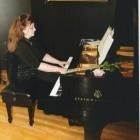 Playing at my students piano recital on a 9 foot Steinway grand piano.I have a recital for all of my students to perform in every 6 months .