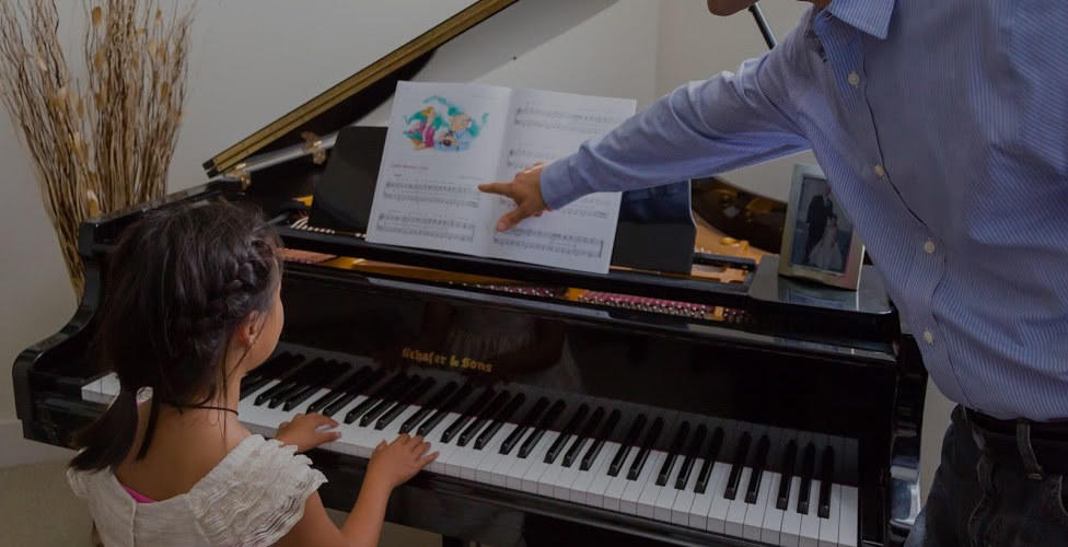 Picture of piano lessons in University